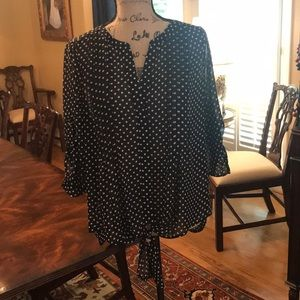 Black sheer top with white polka dots